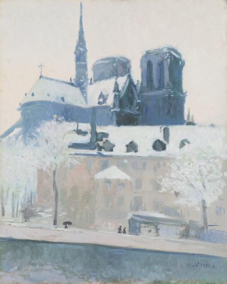 Vista de l'absis de Notre Dame de París, sota la neu